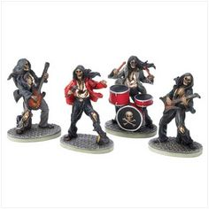 """These macabre musicians are an absolute must for any """"die hard"""" rock and roll rebel at heart! Four fearsome figurines include the skeletal singer, gruesome guitarist, undead bassist, and death's head."""