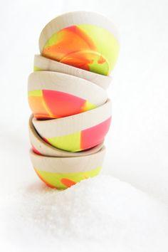Mini wooden neon bowls.