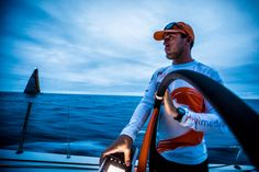 April 19, 2015. Leg 6 to Newport onboard Team Alvimedica. Day 00. Light air and overcast skies for the start of Leg 6 to the USA. Alberto Bolzan adjusts the instrument brightness to better see Abu Dhabi, the wind, and the waves as nightfall approaches. Alvimedica leads the fleet into open water but things are soon mixed up with light and variable winds into the night Amory Ross / Team Alvimedica / Volvo Ocean Race