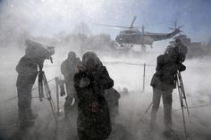 Reporters are whipped by blowing snow as President Obama departs via the Marine One helicopter from the White House in Washington March 6, 2015. REUTERS/Jonathan Ernst