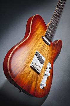 Fender Select Tele with carved Koa top... like the red split up by the natural wood binding