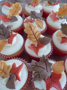 Autumn leaves cupcakes - vanilla cupcakes filled with jam and topped with vanilla buttercream and fondant autumn leaves.