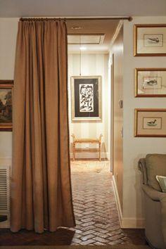 herringbone brick floors and privacy curtain