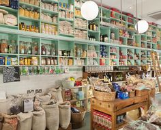 The pale green colour of the shelving in this store make the overly-cluttered grocery store appear lighter, fresher and larger making the clutter appear organized.