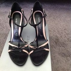 Nine West Black/Pink T-Strap Leather Shoes Cute and sexy leather T-Straps by Nine West. Black trimmed in pink, Size 8M Nine West Shoes Heels