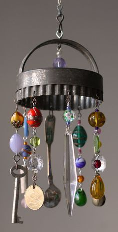 I see this with longer strands and perhaps adding a light?very fun stuff. art projects for kids wind chimes Vintage Upcycle Project DIY's - The Cottage Market Vintage Upcycling, Upcycled Vintage, Repurposed, Garden Crafts, Garden Art, Carillons Diy, Fun Crafts, Diy And Crafts, Cork Crafts