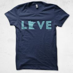 Show your love for your home state.  Printed on a heather navy Softstyle shirt (cotton/poly blend).  A portion of each sale from our MPLSTP line will be donated to charity.