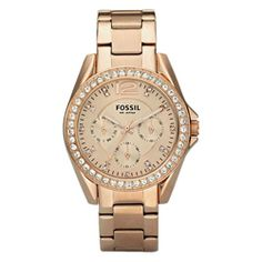 @Overstock - Clear cubic zirconia stones top the bezel and goldtone dial of this glimmering watch from Fossil. A rose-goldtone case and bracelet and three calendar subdials finish the unique look of this casually elegant timepiece.  http://www.overstock.com/Jewelry-Watches/Fossil-Womens-Riley-Multifunction-Rose-goldtone-Glitz-Watch/6113389/product.html?CID=214117 $115.05