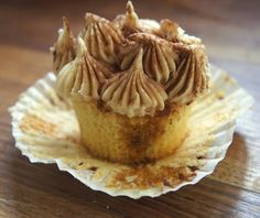 Tiramisu cupcake - Vanilla cupcake,soaked with coffee,filled with coffee mascarpone and topped with coffee cream cheese buttercream dusted with cocao...  in Sweet Revenge cupcake store. Order cupcakes online at www.sweetrevengelondon.com/order-cupcakes/