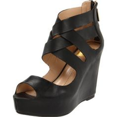 Keep your foot under wraps with this fantastic wedge sandal from DV by Dolce Vita. The Jude wows with a woven leather upper that unzips at the counter for an easy, breezy on-and-off. Beneath, a covered platform balances the high wedge heel, making each step steady and secure.