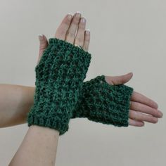 These fingerless gloves, knit in green with a lace patterns will warm your hands, and let you do things like texting and typing. Handmade in