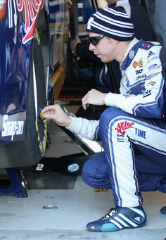 Brad Keselowski Photos - Brad Keselowski, driver of the #2 Miller Lite Ford, works on his car in the garage area during practice for the NASCAR Sprint Cup Series STP 400 at Kansas Speedway on April 20, 2013 in Kansas City, Kansas. - Kansas Motor Speedway - Day 2