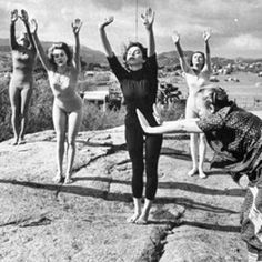 We're celebrating #WomensHistoryMonth and #NationalWomensDay by featuring yoga's lesser known women who helped shape the history of yoga in an otherwise male-dominated space. • Here, we see #IndraDevi teaching yoga to actresses in Hollywood. In the 1930's, Indra became the first female accepted under Sri Krishnamacharya, studying alongside other notable names such as Pattahbi Jois and BKS Iyengar. Not only was she a female pioneer in yoga; Indra went on to be a major proponent for spreading…