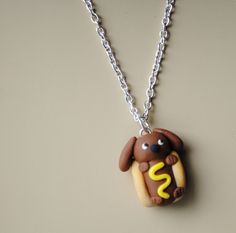 Weiner Dog  Necklace by ClayRunway on Etsy, got this for Faith for Christmas.  It is darling.