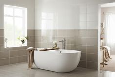 Vibia White £1.32 price/tile £13.37 price/m2 Gloss tile 24.8cm x 39.8cm