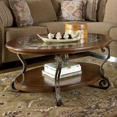 Signature Design by Ashley Nestor Medium Brown Oval Cocktail Table