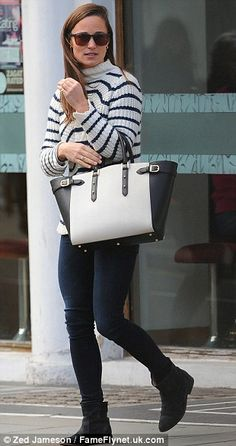 Casual chic: Pippa looked effortlessly glamorous in navy and white with her monochrome bag (sold out, obviously)