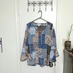 Beautiful patchwork peasant blouse Light and airy peasant blouse. Long tan ribbon ties the wide scoop collar together. Serious flare at the wrists brings it all together and makes it super fun. Caran New York Tops Tunics