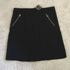 cute skirt  I bought this in Germany, never worn. NWT. Two front pockets, back zipper and fully lined. Waist measurement 16.5 inches and length is approximately 18.5 inches. Smoke and pet free home. Janina Skirts Mini