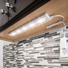 Cabinets need counter lighting  Light up your home with this white LED under-cabinet light. The five LED lights provide plenty of extra lighting, and the fixture is easy to install under your kitchen cabinets. Details: White finish