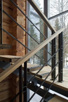 This cozy cottage is a private residence located near Moscow, Russia. The interior makes extensive use of rich wood to add comfort and warmth. First Level / Second Level / Third Level Site Plan Photos by: Irina Kaydalina Indoor Stair Railing, Stair Railing Design, Railings, Philippines House Design, Philippine Houses, Fireplace Doors, Interior Staircase, Metal Stairs, Floating Stairs