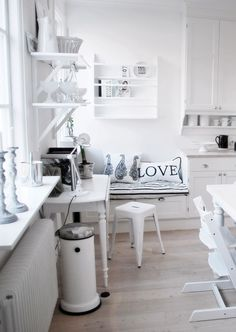 What a cute window seat! Love the crisp, clean, simplicity of the calming kitchen area.