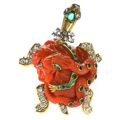 CARTIER PARIS Superb Carved Coral Diamond and Emerald Turtle Pin. France, 1950c. photo by Macklowe Gallery