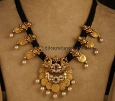 Black cord necklace with antique work peacock and round Lakshmi coins attached clasps all over. Pachi work lakshmi pendant in chandbali . Thread Jewellery, Coin Jewelry, Beaded Jewelry, Jewelry Necklaces, Diamond Jewellery, Temple Jewellery, Bridal Jewellery, Wedding Jewelry, Ruby Jewelry