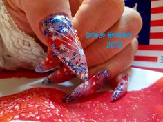 I did these nails in July 2012 and they are in the Readers Nail art section of Nails Magazine July 2013 Issue. They have stars and long tinsel strands embedded in the acrylic . They are suppose to look like fireworks shooting off .