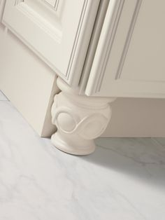Place furniture grade decorative feet under select cabinetry