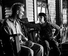"""Boo Radley and Scout in To Kill a Mockingbird """"Boo was our neighbor.  He gave us two soap dolls, a broken watch and chain, a knife and our lives."""""""