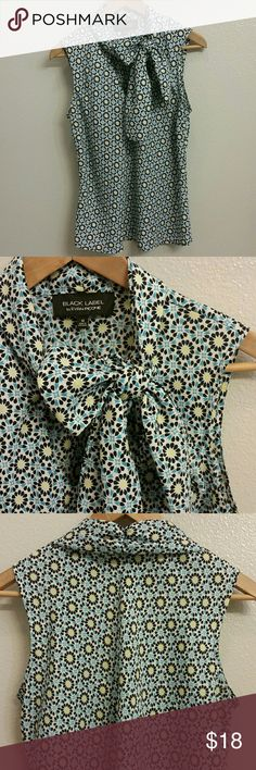 Tie-neck Flower Blouse Cute floral sleeveless blouse printed with yellow, navy, and turquoise blue daisy flowers; fabric ties at the neck; Black Label by Evan-Picone; Dry Clean Only; Lightweight 100% Polyester; Excellent condition Evan Picone Tops Blouses