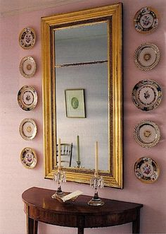 plates as wall decor and, of course, the gold mirror!