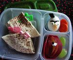 Angry Bird: Chicken salad in Pita Bread, Hardboiled egg decorated with Cheese and nori and fruits.""
