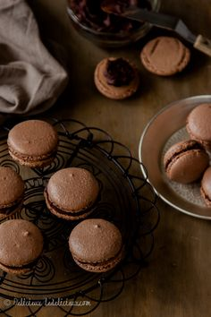 ... French treat! Chocolate macarons filled with dark chocolate ganache