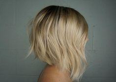 Gorgeous baby blonde hair color with an angled bob by Aveda Artist Angel K.