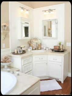 really like the corner basin design w/the two mirrors. same for second basin The Old Painted Cottage Unique Goods and Curious Finds Bathroom Sink Units, Corner Bathroom Vanity, Double Sink Bathroom, Bathroom Renos, Bathroom Layout, Bathroom Interior, Small Bathroom, Bathroom Cabinets, Mirror Cabinets