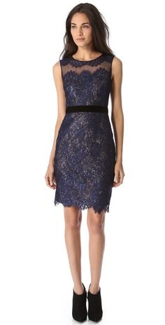 Elegant sleeveless lace dress in midnight blue with a touch of sparkle. Notte by Marchesa