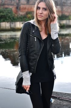 Grey hoodie under a black leather jacket.