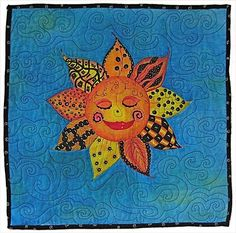 This art quilt is a sun image hand-painted using zendoodle patterns. This quilt has appeared on the TV show CBS Sunday Morning. It would be great in a child's room.