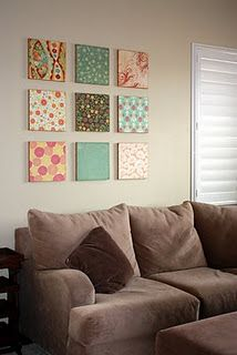 How cute is this? I also thought about doing a single large canvas or multiple large canvases using bands of fabric running either horizontal or diagonal.