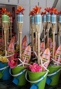 Adding tiki torches to the buckets- for An ADULT party throw a couple Corona's and lime- and you are set!