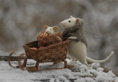Mama mouse pushing baby in sleigh by Natasha Fadeeva - Newest Work