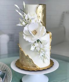 Gold and white cake by Honey Love Cakery