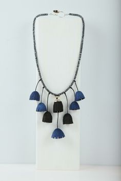 silver necklace with silk cocoon and semiprecious stones