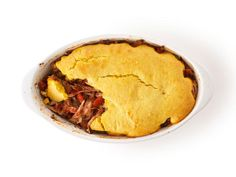 Pork Tamale Pie : Place the pork in a baking dish, toss with salsa and top with your favorite cornbread batter. Bake at the oven temperature instructed in the cornbread recipe until the cornbread is cooked through.