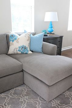 grey living room with blue