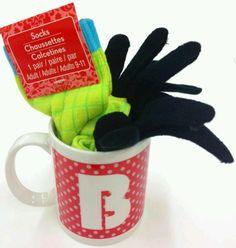 Mug, hot chocolate package, socks and gloves.