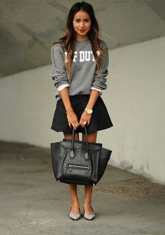 Grey sweater and black skirt