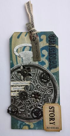 Tim Holtz Jan tag 2014 - Die cut the pocket watch, and used a Sizzix clocks embossing folder on the centre.